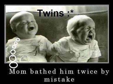 Twins with one crying and one laughing