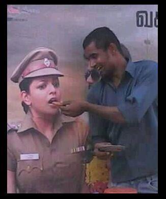 Kajal Aggarwal eating biscuit